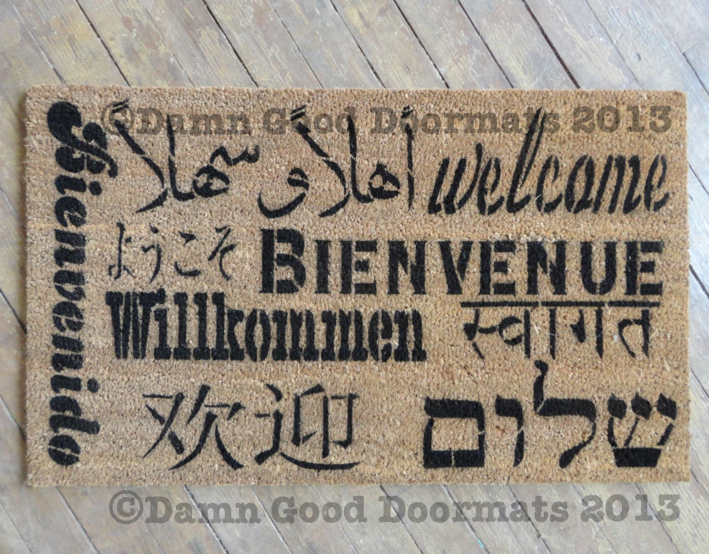 Welcome in all languages doormat, English, Spanish, French, German, Arabic, Hebrew, Chinese, Japanese, Korean, and Hindi